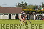 Trevor Wallace (Ardfert) gets challenged in the air by An Gaeltacht's GearÛid Mac an tSaoire.