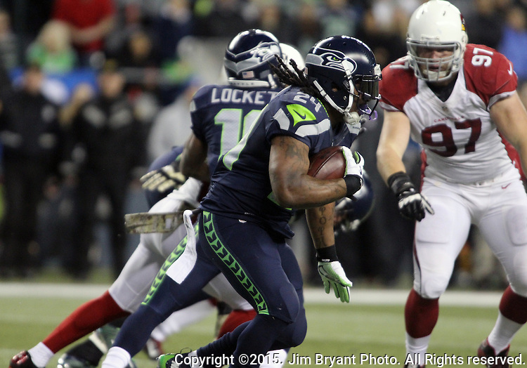 Seattle Seahawks  running back Marshawn Lynch (24) rushes against the Arizona Cardinals at CenturyLink Field in Seattle, Washington on November 15, 2015. The Cardinals beat the Seahawks 39-32.   ©2015. Jim Bryant photo. All Rights Reserved.