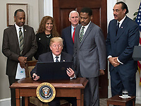 United States President Donald J. Trump signs a proclamation to honor Dr. Martin Luther King, Jr. Day in the Roosevelt Room of the White House in Washington, DC on Friday, January 12, 2018.<br /> Credit: Ron Sachs / CNP /MediaPunch