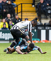 Anthony Stewart of Wycombe Wanderers lays on the ball as Stanley Aborah of Notts County lands on him during the Sky Bet League 2 match between Notts County and Wycombe Wanderers at Meadow Lane, Nottingham, England on 28 March 2016. Photo by Andy Rowland.