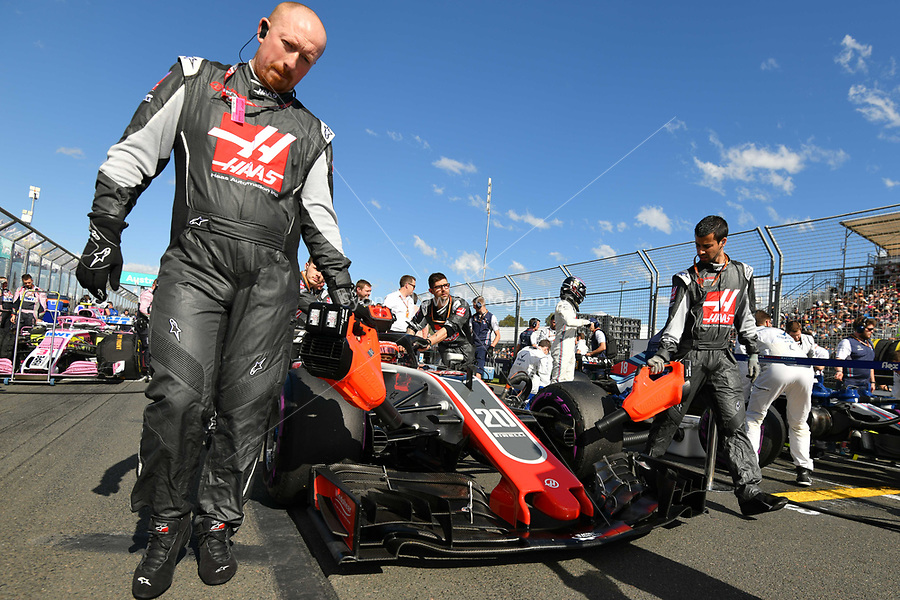 March 25, 2018: Mechanics wheel the car of Kevin Magnussen (DEN) #20 from the Haas F1 Team on the grid prior to the start of the 2018 Australian Formula One Grand Prix at Albert Park, Melbourne, Australia. Photo Sydney Low