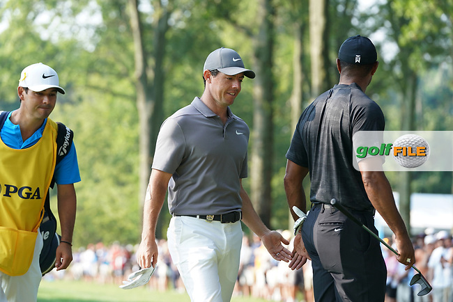 Tiger Woods (USA) gets a high five from Rory McIlroy (NIR) as they walk to the 15th tee during the second round of the 100th PGA Championship at Bellerive Country Club, St. Louis, Missouri, USA. 8/11/2018.<br /> Picture: Golffile.ie | Brian Spurlock<br /> <br /> All photo usage must carry mandatory copyright credit (© Golffile | Brian Spurlock)