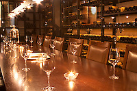 A wine tasting room with glasses on the table and lit candles. Wine racks with old wine bottles in the background. Ulriksdal Ulriksdals Wärdshus Värdshus Wardshus Vardshus Restaurant, Stockholm, Sweden, Sverige, Europe