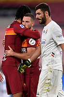 Jordan Veretout of AS Roma celebrates with Chris Smalling of AS Roma while Pietro Terracciano of ACF Fiorentina looks dejected, after scoring on penalty the goal of 2-1 during the Serie A football match between AS Roma and ACF Fiorentina at stadio Olimpico in Roma (Italy), July 26th, 2020. Play resumes behind closed doors following the outbreak of the coronavirus disease. <br /> Photo Antonietta Baldassarre / Insidefoto