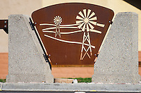 """Iron plates with windmill cutouts play a key part of the Grand Avenue Beautification Project.  This was part of the 2015 rebuild of the Grand Avenue and Diamond Bar Boulevard intersection for Diamond Bar's 2015 """"Grand Avenue Beautification"""" project, landscape architecture for the project was by David Volz Design."""