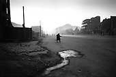 Kabul, Afghanistan<br /> November 19, 2001<br /> <br /> A man makes his way down main street at dusk.
