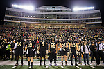 (L-R) Wake Forest Demon Deacons captains Wendell Dunn (14), John Wolford (10), Jaboree Williams (6), A'Lique Terry (55), Grant Dawson (50), and Cam Serigne (85) prepare to walk to midfield for the coin toss prior to the start of the game against the North Carolina State Wolfpack at BB&T Field on November 18, 2017 in Winston-Salem, North Carolina.  (Brian Westerholt/Sports On Film)
