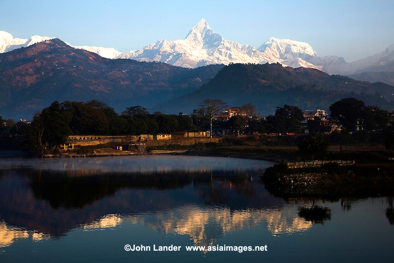 """Fishtail Mountain, in the Annapurna Range, as seen from Sarangkot, a Himalaya viewing spot near the popular town of Pokhara. Fishtail may not be the highest summit of the Himalayas, but it is one of the most dramatic thanks to its shape, which looks like a """"fishtail"""" to Nepali eyes. Phewa Tal or Lake Fewa is the second largest lake in Nepal. On a clear day, majestic views of the Annapurna Range of the Himalayas reflects on the lake. Phewa Tal or Lake Fewa is the second largest lake in Nepal. On a clear day, majestic views of the Annapurna Range of the Himalayas reflects on the lake."""
