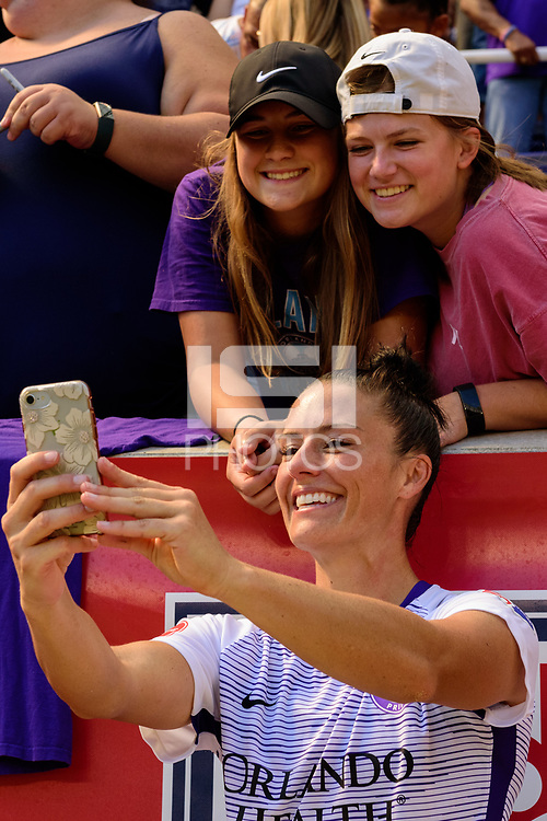 HARRISON, NJ - SEPTEMBER 29: Ali Krieger #11 of the Orlando Pride takes a selfie with fans after the match during a game between Orlando Pride and Sky Blue FC at Red Bull Arena on September 29, 2019 in Harrison, New Jersey.