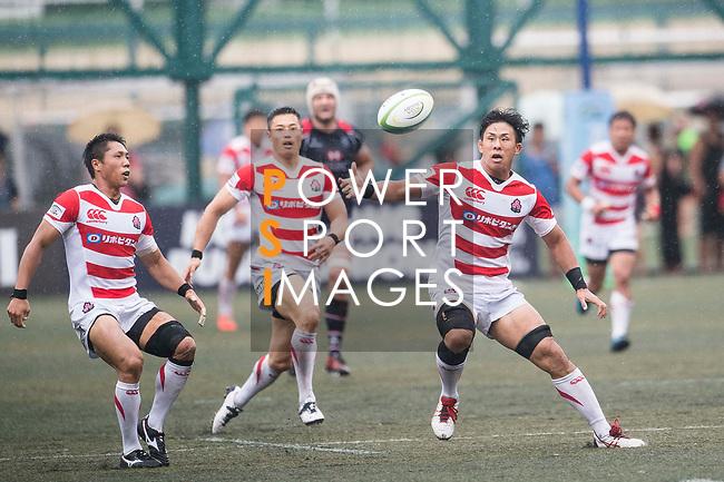 Yoshitaka Tokunaga of Japan (R) in action during the Asia Rugby Championship 2017 match between Hong Kong and Japan on May 13, 2017 in Hong Kong, China. Photo by Marcio Rodrigo Machado / Power Sport Images