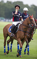 Apichet Srivaddhanaprabha (King Power) after his team wins the Cartier Trophy Final match between King Power and Salkeld at the Guards Polo Club, Windsor, Smith's Lawn, England on 14 June 2015. Photo by Andy Rowland.