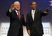 New York, NY - September 22, 2009 -- United States President Barack Obama (R) and former President Bill Clinton arrive at the Clinton Global Initiative at the Sheraton Hotel in New York City on Tuesday, September 22, 2009.   .Credit: John Angelillo / Pool via CNP