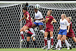 19 August 2012: Duke's Natasha Anasi (4) heads the ball away from Elon's Simi Dhaliwal (19), Chelsey Stark (27) and Duke's Libby Jandl (3). The Duke University Blue Devils defeated the Elon University Phoenix 8-0 at Koskinen Stadium in Durham, North Carolina in a 2012 NCAA Division I Women's Soccer game.
