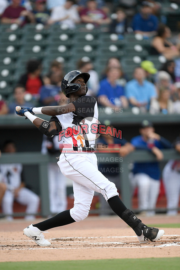 Shortstop Ronny Mauricio (2) of the Columbia Fireflies bats in a game against the Lexington Legends on Thursday, June 13, 2019, at Segra Park in Columbia, South Carolina. Lexington won, 10-5. (Tom Priddy/Four Seam Images)