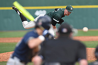 Starting pitcher Kevin Hickey (32) of the University of South Carolina Upstate Spartans delivers a pitch in a game against the Pittsburgh Panthers on Saturday, February 24, 2018, at Cleveland S. Harley Park in Spartanburg, South Carolina. Pittsburgh won, 3-1. (Tom Priddy/Four Seam Images)