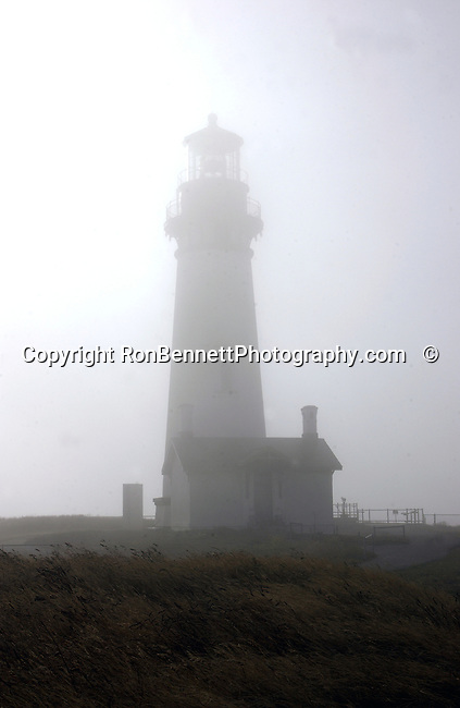 Yaquina Head Lighthouse in fog Newport Oregon, window, Oregon, Yaquina Head lighthouse has a marble floor and is 162 feet above sea level and can be seen by ships 19 miles away, Pacific Ocean, Plains, woods, mountains, rain forest, desert, rain, Pacific Northwest, Fine art Photography and Stock Photography by Ronald T. Bennett Photography ©, Fine Art Photography by Ron Bennett, Fine Art, Fine Art photography, Art Photography, Copyright RonBennettPhotography.com © Fine Art Photography by Ron Bennett, Fine Art, Fine Art photography, Art Photography, Copyright RonBennettPhotography.com ©