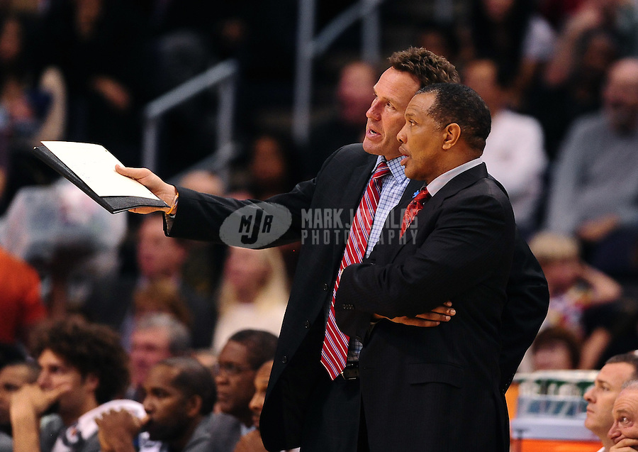 Jan. 28, 2012; Phoenix, AZ, USA; Phoenix Suns head coach Alvin Gentry (right) talks with assistant coach Dan Majerle against the Memphis Grizzlies at the US Airways Center. The Suns defeated the Grizzlies 86-84. Mandatory Credit: Mark J. Rebilas-USA TODAY Sports