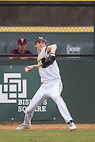 Michigan Wolverines outfielder Jackson Lamb (10) makes a throw from the outfield during the NCAA baseball game against the Washington Huskies on February 16, 2014 at Bobcat Ballpark in San Marcos, Texas. The game went eight innings, before travel curfew ended the contest in a 7-7 tie. (Andrew Woolley/Four Seam Images)