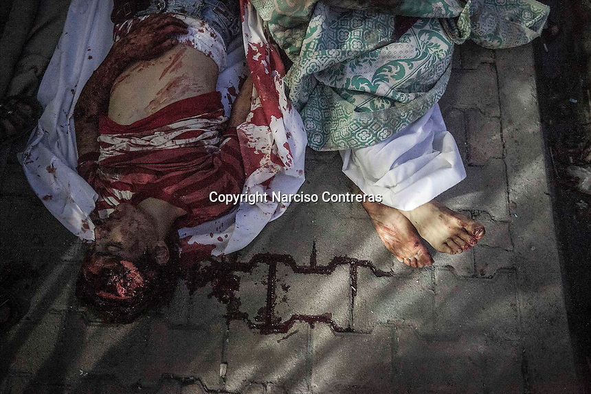 Dead bodies of Syrian civilians lie down on the street outside a hospital after were killed during aircraft shelling in Bustan Al-Bashar neighborhood at the north of Aleppo City.