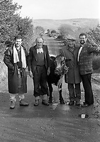 1992 The Blackwater Taverm (owner Teddy O'Neill) Direendraugh, Blackwater, Sneem, County Kerry Ireland 1992:  The Gay Byrne Radio Show, (Ireland's most listened to show) celebrated 'Big Bertha', reaching 48 years of age and appearing in the Guinness Book of Records as the world's oldest cow. In this photograph show Joe Duffy and owner Farmer Jerome O&rsquo;Leary and tow locals in the pub as the party is broadcast live on air in 1992. Bertha left her 'mark' on the floor during the transmission.<br /> Big Bertha died on New Year's Eve 1993.<br /> Photo: Don MacMonagle <br /> e: info@macmonagle.com