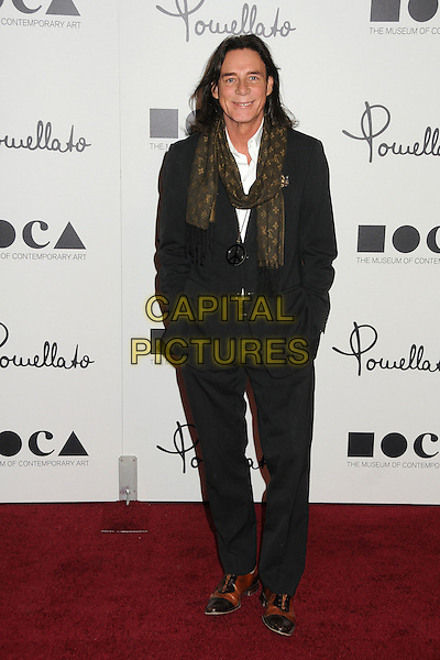 George Blodwell.Pomellato Celebrates Rodeo Drive Boutique Opening Hosted By Tilda Swinton, Benefiting MOCA held at Pomellato Boutique, Beverly Hills, California, USA..January 30th, 2012.full length black suit green scarf hands in pockets .CAP/ADM/BP.©Byron Purvis/AdMedia/Capital Pictures.