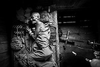 Last days of an elder cambodian man within a special ward of Dam Dek medical center.