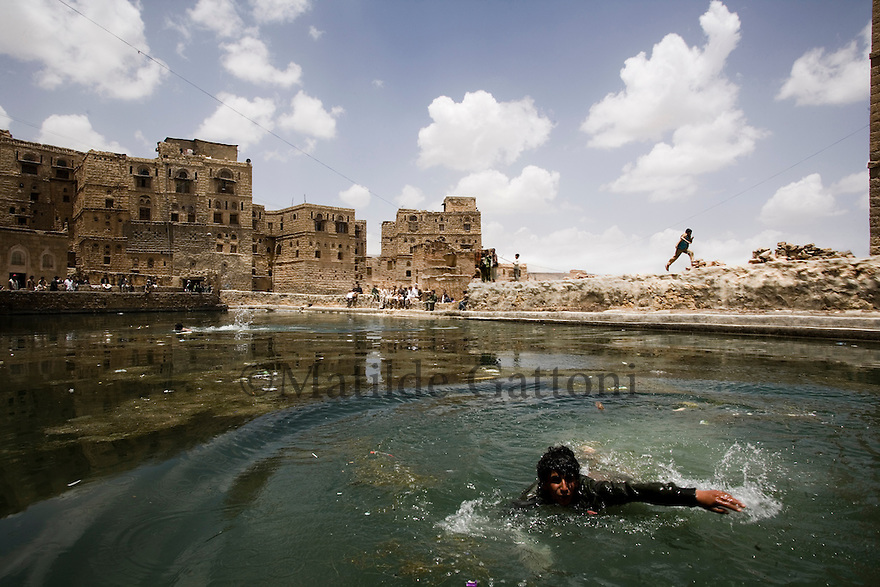 Yemen - Water reservoir of a village. The rain water is used to cook, wash clothes, swim, animals. Yemen's economy depends heavily on oil production, and its government receives the vast majority of its revenue from oil taxes. Yet analysts predict that the country's petroleum output, which has declined over the last seven years, will fall to zero by 2017. The government has done little to plan for its post-oil future. Yemen's population, already the poorest on the Arabian peninsula and with an unemployment rate of 35%, is expected to double by 2035..The trends will exacerbate large and growing environmental problems, including the exhaustion of Yemen's groundwater resources. Given that a full 90% of the country's water is used for agriculture, this trend portends disaster..Sanaa's well are expected to dry out by 2015, partly due to illegal drilling, partly because 40% of the city's water is diverted for qat production, and partly because conservation rules are difficult to enforce. Only 20% of the houses receive water, the other 80% has to collect it from pumps and wells. 15% of the urban population only uses bottled water as its primary drinking water source and that is why Yemen has one of the highest world mortality rate, most of the diseases being related to water..