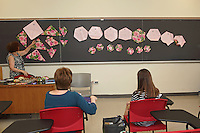 OrigamiUSA 2016 Convention at St. John's University, Queens, New York, USA. Sandra Richman, New York, teaches a class Star Dish. Sandra uses magnets to show the sequence of folds on a blackboard.