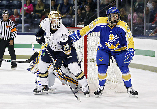 October 18, 2014:  Notre Dame left wing Anders Bjork (10) and Lake Superior State defenseman Aidan Wright (22) battle in front of the net during NCAA Hockey game action between the Notre Dame Fighting Irish and the Lake Superior State Lakers at Compton Family Ice Arena in South Bend, Indiana.  Notre Dame defeated Lake Superior State 5-1.