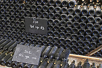 Piles of old bottles aging in the cellar, rouge red 1983 and 2000 Chateau Vannieres (Vannières) La Cadiere (Cadière) d'Azur Bandol Var Cote d'Azur France