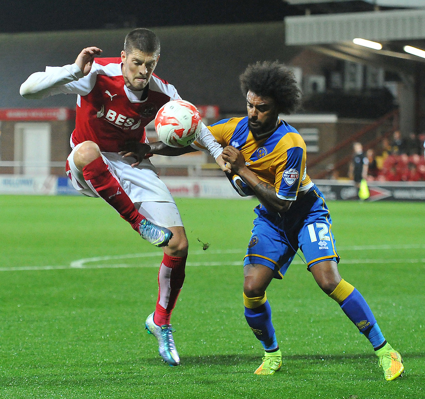 Fleetwood Town's Jamie Proctor battles with Shrewsbury Town's Junior Brown<br /> <br /> Photographer Dave Howarth/CameraSport<br /> <br /> Football - Johnstone's Paint Trophy Northern Section Second Round - Fleetwood Town v Shrewsbury Town - Tuesday 6th October 2015 - Highbury Stadium - Fleetwood<br />  <br /> &copy; CameraSport - 43 Linden Ave. Countesthorpe. Leicester. England. LE8 5PG - Tel: +44 (0) 116 277 4147 - admin@camerasport.com - www.camerasport.com