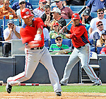 5 March 2011: Washington Nationals' infielder Jerry Hairston Jr. swings at bat as Ian Desmond stands in the on deck circle during a Spring Training game against the New York Yankees at George M. Steinbrenner Field in Tampa, Florida. The Nationals defeated the Yankees 10-8 in Grapefruit League action. Mandatory Credit: Ed Wolfstein Photo