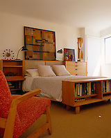 The bedroom is furnished with a collection of mid 20th-century furniture and the chair in the foreground is by Ralph Rapson