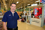 Ramond McEvoy with his mobile phone on the Tesco Ireland Mobile phone network at work n the Tesco Extra store in Drogheda, Co Louth.<br /> Picture: www.newsfile.ie