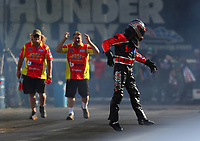 Jun 16, 2017; Bristol, TN, USA; Crew members react as NHRA top fuel nitro Harley Davidson rider Chris Smith jumps off his bike after an explosion during qualifying for the Thunder Valley Nationals at Bristol Dragway. Mandatory Credit: Mark J. Rebilas-USA TODAY Sports