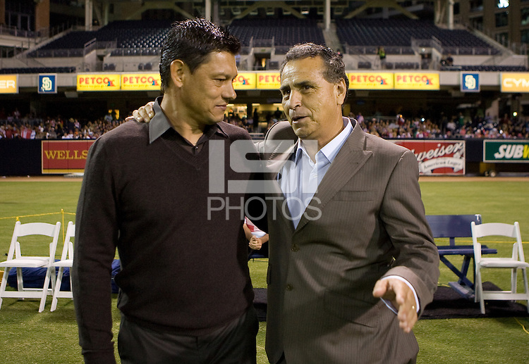 Head Coaches of Chivas de Guadalajara Jose Luis Real (r) and Chivas USA Martin Vasquez (l) chat prior to the game. Chivas USA and CD Chivas de Guadalajara played to 0-0 draw at Petco Park stadium in San Diego, California on Tuesday September 14, 2010.