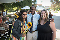 Black Graduation Celebration at Academic Quad, May 20, 2017.<br /> Cultural Graduation Celebrations are an opportunity for smaller groups to come together and acknowledge students' accomplishments with family and friends while celebrating the rich diversity of our campus. The Office of Intercultural Affairs partners with cultural organizations to coordinate the events.<br /> (Photo by Marc Campos, Occidental College Photographer)