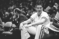 OAKLAND, CA - Chris Mullin of the Golden State Warriors watches from the bench during a game at the Oakland Coliseum Arena in Oakland, California in 1988. Photo by Brad Mangin