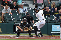 Bradenton Marauders third baseman Chris Diaz (5) at bat in front of catcher Chris Hoo and umpire Dave Attrdige during a game against the Jupiter Hammerheads on April 18, 2015 at McKechnie Field in Bradenton, Florida.  Bradenton defeated Jupiter 4-1.  (Mike Janes/Four Seam Images)