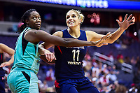 Washington, DC - June 15, 2018: Washington Mystics guard Elena Delle Donne (11) and New York Liberty center Tina Charles (31) fight for position in the post during game between the Washington Mystics and New York Liberty at the Capital One Arena in Washington, DC. (Photo by Phil Peters/Media Images International)