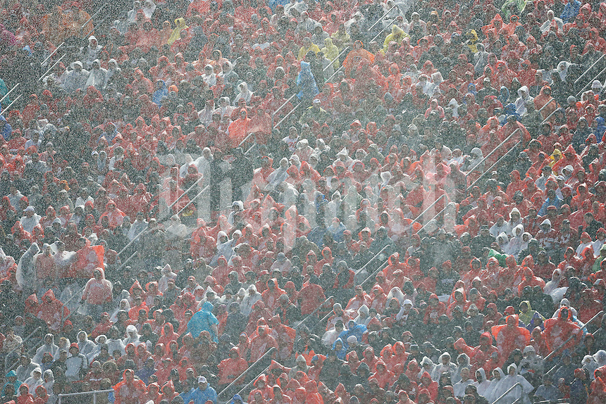 Fans sit in heavy rain during the second quarter of the NCAA football game between Ohio State Buckeyes and Michigan State Spartans at Ohio Stadium in Columbus on Nov. 21, 2015. (Adam Cairns / The Columbus Dispatch)