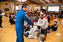 January 27, 2012, Natori, Japan - Japanese astronaut Satoshi Furukawa shakes hands with a school child during his visit to an elementary school in Natori City, Miyagi Prefecture, some 293 km northeast of Tokyo, on Friday, January 27, 2012. Furukawa talked about his mission for the 167-day stay at the International Space Station during his visit to the school in the area affected by the Great East Japan Earthquake. (Photo by AFLO) UUK -mis-