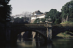 The Niju-Bashi, Double Bridge, on the Imperial Palace grounds in Tokyo, Japan. The Imperial Palace grounds are the site of Edo Castle, founded in the 15th century. The present Imperial Castle, situated almost in the center of Tokyo's vast urban area, was burnt down and destroyed during the Tokyo fire bombings by American bombers during World War II. A new 4,000 square meter, one-story  palace was rebuilt in 1968. (Jim Bryant Photo).....
