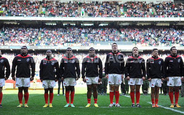 Army players line up for the national anthem. Babcock Inter-Services Championship match between the British Army and the Royal Navy on May 3, 2014 at Twickenham Stadium in London, England. Photo by: Patrick Khachfe / Onside Images