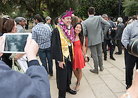 Chris Hino and Kris Koke '14. The class of 2015 graduates during Occidental College's 133rd Commencement, the Remsen Bird Hillside Theater, on Sunday, May 17, 2015.<br />
