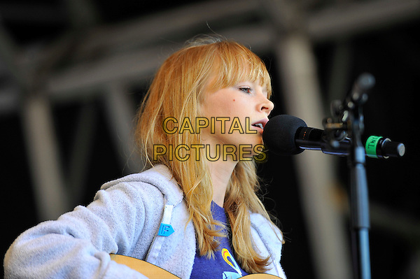 Lucy Rose<br /> attending The Big IF, Hyde Park, London, England. <br /> 8th June 2013<br /> half length profile purple fleece on stage in concert live gig performance performing music singing<br /> CAP/MAR<br /> &copy; Martin Harris/Capital Pictures