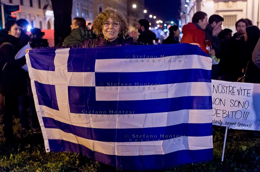 Roma 11 Febbraio 2015<br /> Manifestazione di solidariet&agrave; al popolo greco, sotto l&rsquo;Ambasciata Tedesca, contro la dittatura della Troika contro austerity e  il ricatto del debito e per un&rsquo;Europa unita dalle lotte e dalla solidariet&agrave;. Manifestante con la bandiera greca<br /> Rome February 11, 2015<br /> Demonstration of solidarity with the people greek, in front the German Embassy, against the dictatorship of the Troika against austerity and the blackmail of the debt and for a united Europe from the struggles and solidarity. Protestor with the Greek flag