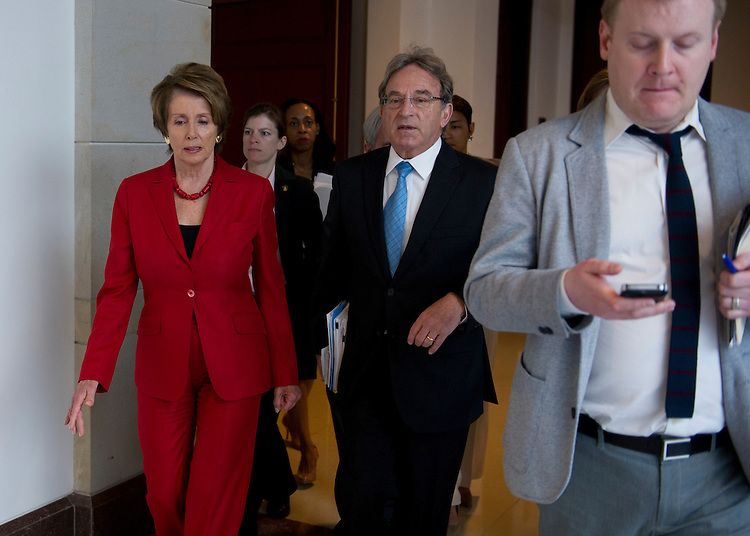 UNITED STATES - May 16: Majority Leader Nancy Pelosi, D-CA., walks though the Capitol Visitors Center with her staff on May 16, 2013.(Photo By Douglas Graham/CQ Roll Call)