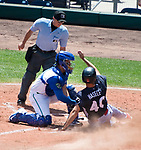 HARTFORD,  CT-071818JS08--Reading's  Adam Haseley (40) is tagged out at home plate by Yard Goat's Chris Rabago (4), while trying to score on a fly ball, during the first game of a double-header Wednesday afternoon at Dunkin Donuts Park in Hartford.<br /> Jim Shannon Republican American