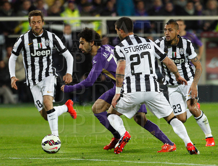 Calcio, Coppa Italia: semifinale di ritorno Fiorentina vs Juventus. Firenze, stadio Artemio Franchi, 7 aprile 2015. <br /> Fiorentina's Mohamed Salah, center, is challenged by Juventus' Claudio Marchisio, left, Stefano Sturaro, second from right, and Arturo Vidal, during the Italian Cup semifinal second leg football match between Fiorentina and Juventus at Florence's Artemio Franchi stadium, 7 April 2015.<br /> UPDATE IMAGES PRESS/Isabella Bonotto